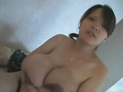 Pregnant Japanese milf exposes her large udders