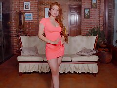 Interesting redhead babe Angelina Praga gets released from dress to go solo